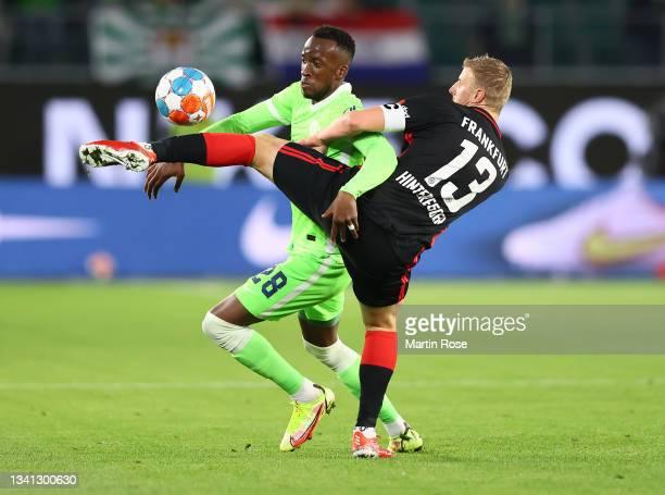 Dodi Lukebakio of Wolfsburg fights for the ball with Martin Hinteregger of Frankfurt during the Bundesliga match between VfL Wolfsburg and Eintracht...