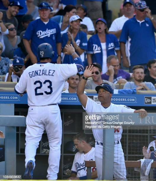 Dodngers manager Dave Roberts congratulates Adrian Gonzalez after scoring in the in the 4th inning in Los Angeles CA on Saturday July 9 2016 Dodgers...