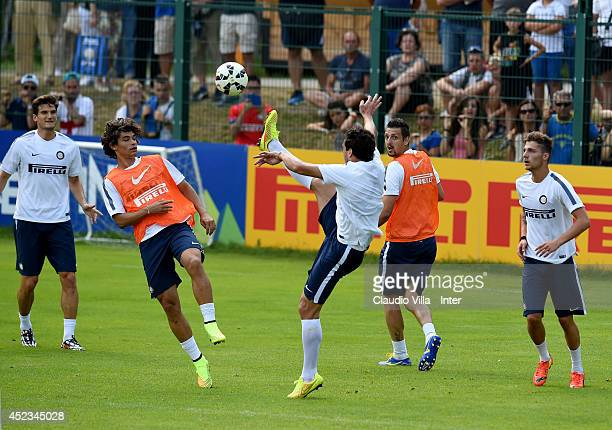 Dodo and Matias Silvestre compete for the ball during a FC Internazionale Milano training session on July 18 2014 in Pinzolo near Trento Italy