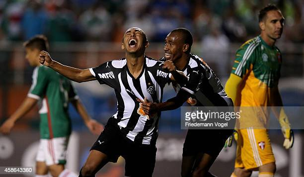 Dodo of Atletico celebrates scoring the second goal with Eduardo during the match between Palmeiras and Atletico MG for the Brazilian Series A 2014...