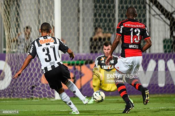 Dodo of Atletico MG and Paulo Victor and Marcelo of Flamengo battle for the ball during a match between Atletico MG and Flamengo as part of...