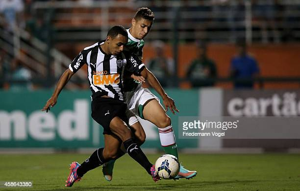 Dodo of Atletico scoring the second goal during the match between Palmeiras and Atletico MG for the Brazilian Series A 2014 at Pacaembu Stadium on...