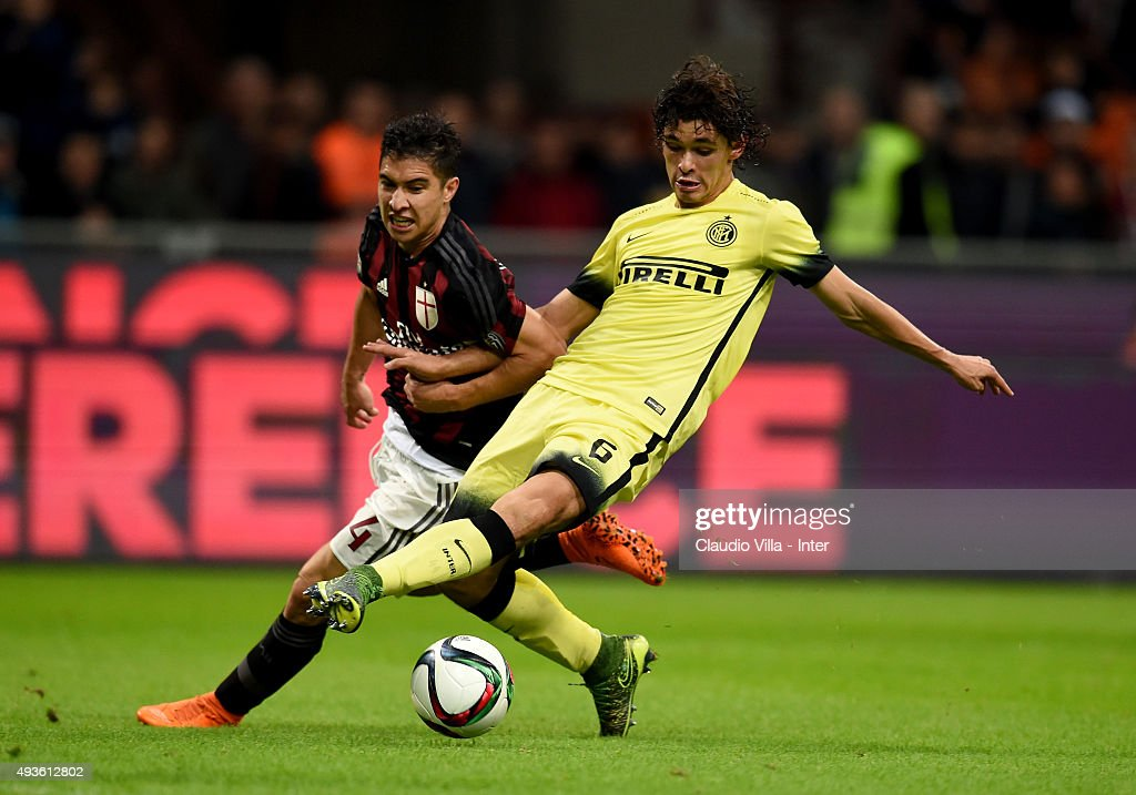 Dodo of FC Internazionale (R) and Jose Mauri of AC Milan compete for the ball during the Berlusconi Trophy match between AC Milan and FC Internazionale at Stadio Giuseppe Meazza on October 21, 2015 in Milan, Italy.