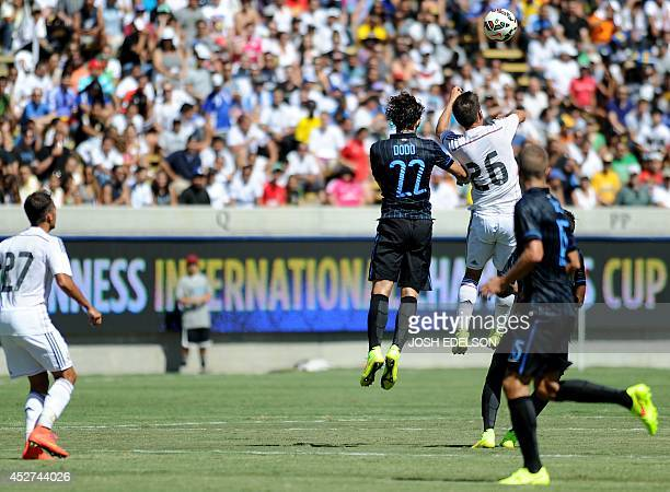 Dodo of Inter Milan jumps for the ball alongside Alvaro Medran of Real Madrid during an International Champions Cup match in Berkeley California on...