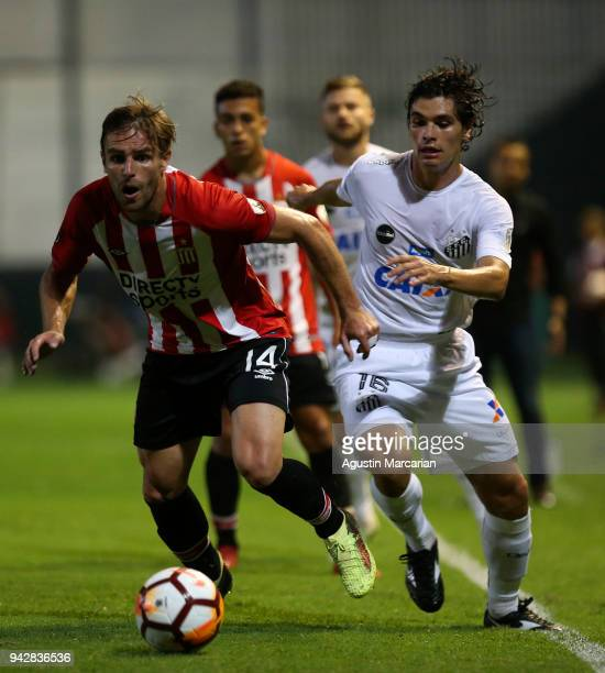 Dodo of Santos fights for the ball with Facundo Sanchez of Estudiantes during a match between Estudiantes and Santos as part of Copa CONMEBOL...