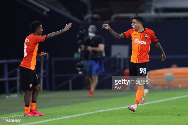 Dodo of Shakhtar Donetsk celebrates after scoring his sides fourth goal with teammate Marcos Antonio during the UEFA Europa League Quarter Final...