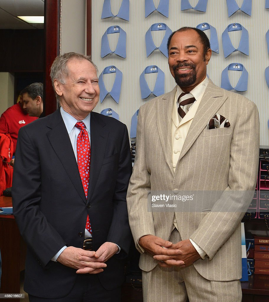 Doe Fund founder George McDonald (L) and former basketball player Walt 'Clyde' Frasier attend the 2013 Mohan's Winter Coat Drive benefiting The Doe Fund at Mohan's Custum Tailors on December 19, 2013 in New York, United States.