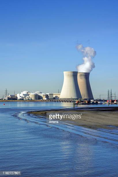 Doel Nuclear Power Station / nuclear power plant in the Antwerp harbour along the river Scheldt / Schelde, Flanders, Belgium.