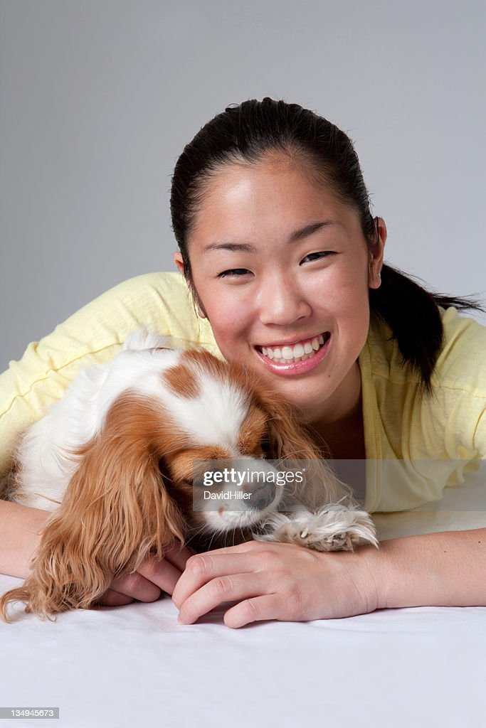 Dog and Asian Teen : Stock Photo