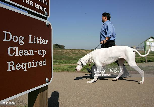 A dog and its owner walk by a sign about litter cleanup at Ft Funston February 24 2006 in San Francisco San Francisco is on its way to being the...