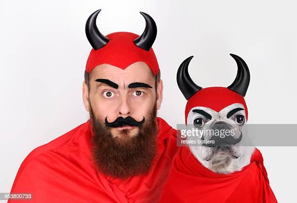 Dog and man dressed demons
