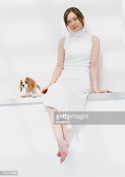 dog and woman - 座る ストックフォトと画像