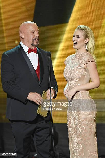 Dog Bermudez and Kimberly Dos Ramos speak onstage during Premios Univision Deportes 2016 on December 18 2016 in Miami Florida