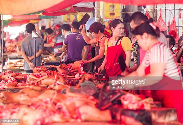Dog bodies are put on the desk for sales at a free market ahead the Yulin Dog Eating Festival in Yulin city, south China's Guangxi Zhuang Autonomous...