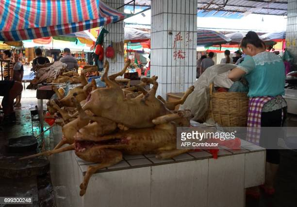 Dog carcasses are stacked at a dog meat market in Yulin, in China's southern Guangxi region on June 21, 2017. China's most notorious dog meat...