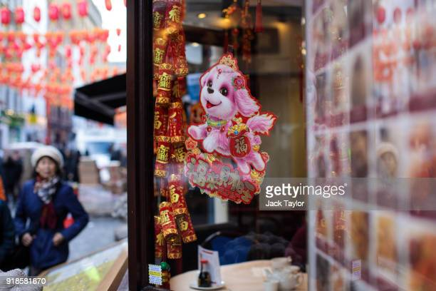 A dog decoration sits in the window of a restaurant in Chinatown ahead of Chinese New Year tomorrow on February 15 2018 in London England Chinese New...