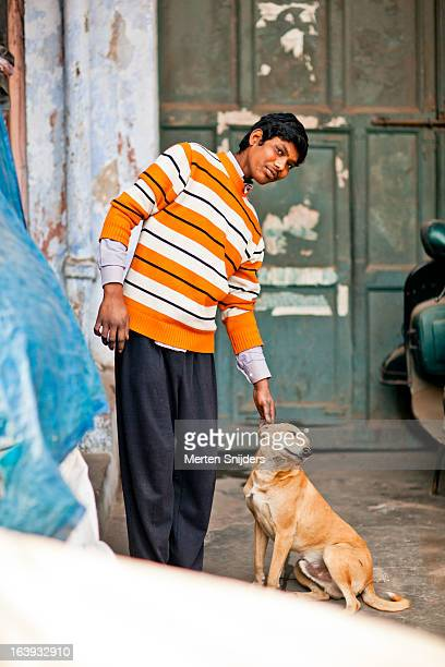dog enjoys being pet by young man - merten snijders stock pictures, royalty-free photos & images