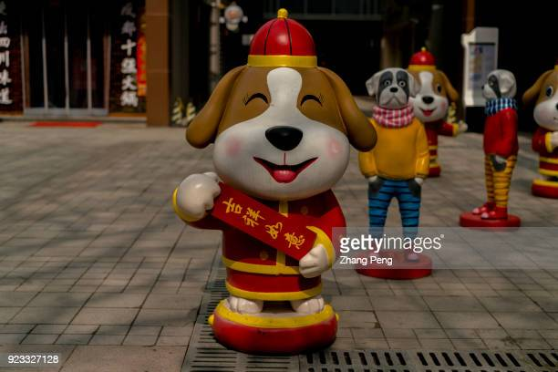 Dog figurines stand at roadside wishing a fortunate new year to pedestrians 2018 is the year of Dog in Chinese lunar calendar
