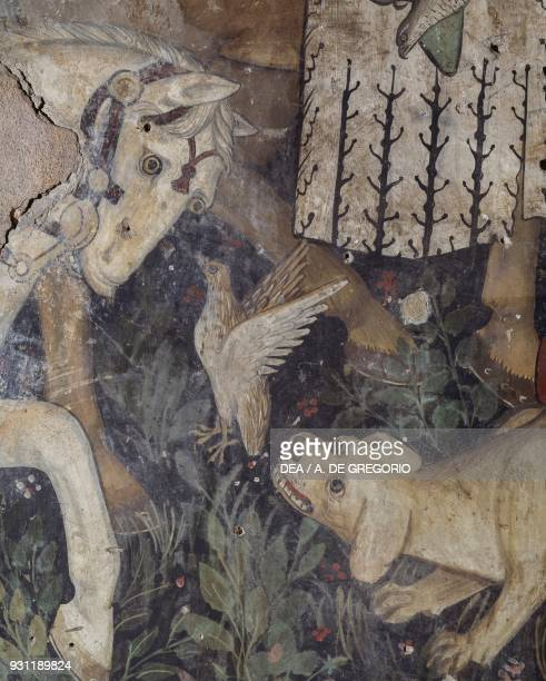 Dog flushing out a bird a horse and a falcon detail from the Fountain of Youth fresco in the Baronial Hall Castle of Manta Saluzzo Piedmont Italy...