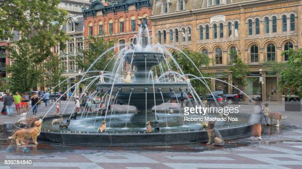 Dog fountain in Berczy Park Old Toronto The cast iron attraction was designed by landscape architect Claude Cormier Nowadays it is a tourist...