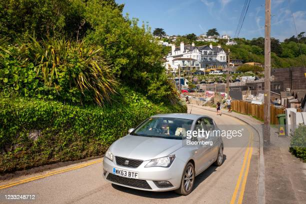 Dog in the passenger seat of a car driving away from the Carbis Bay Hotel, the venue for the upcoming Group of Seven leaders summit, in Carbis Bay,...