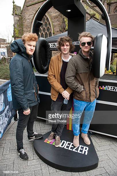 'Dog Is Dead' pose before they perform as part of the Deezer Bandwagon Tour which celebrates the launch of a free music streaming service in the UK...