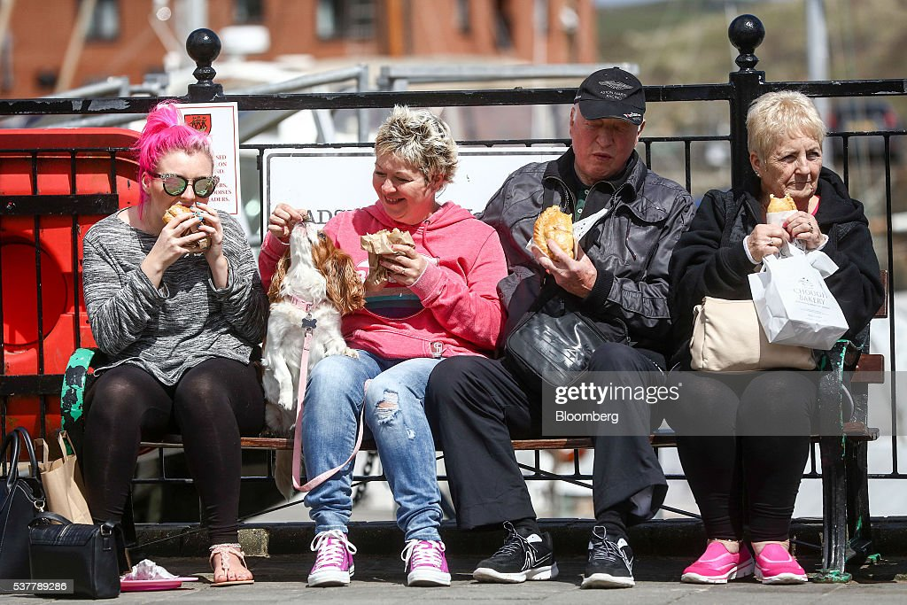 A dog is fed a piece of Cornish pasty from the Chough Bakery in Padstow, Cornwall, U.K., on Thursday, April 28, 2016. Cornish Pasties are one of the U.K.'s food products that are protected against imitation throughout the European Union under regulations that recognize regional and traditional foods. Photographer: Simon Dawson/Bloomberg via Getty Imagesv