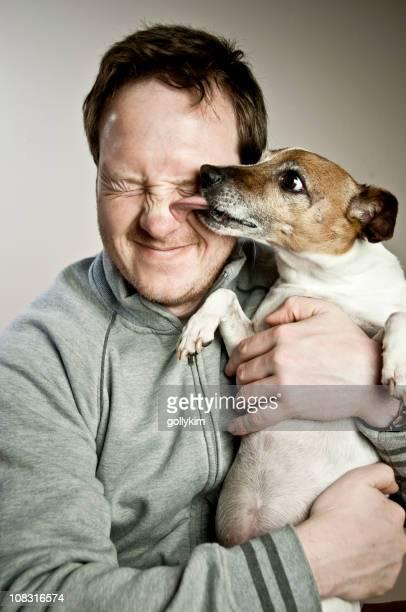 Dog licking man's face
