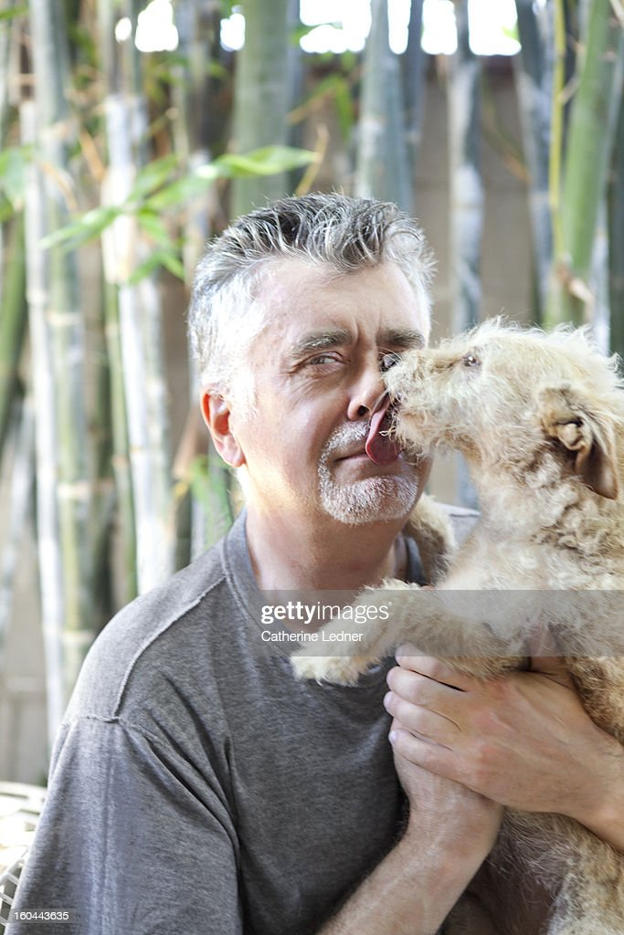Dog Licking Middle Aged Man : Stock Photo