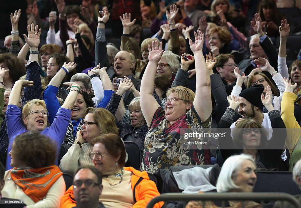 Dog lovers do the wave at the 137th Westminster Kennel Club Dog Show on February 12, 2013 in New York City. A total of 2,721 dogs from 187 breeds and varieties competed in the event, hailed by organizers as the second oldest sporting competition in America, after the Kentucky Derby.