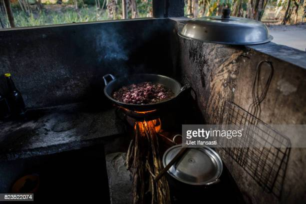 Dog meat is cooked at a restaurant specialising in dog meat on July 25 2017 in Yogyakarta Indonesia Indonesians have seen a surprising hike in dog...