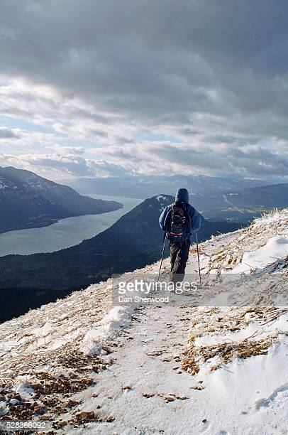 Dog Mountain, Washington, USA; Hiker on snow-covered trail