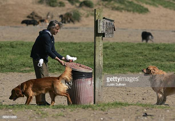 A dog owner discards a bag with dog feces at Ft Funston February 24 2006 in San Francisco San Francisco is on its way to being the first city in the...