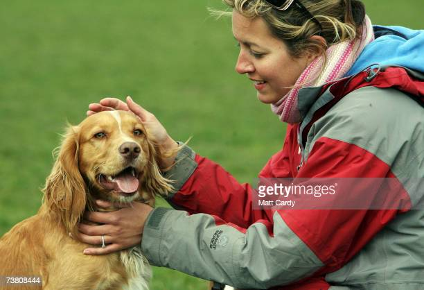 Dog owner Fen Reilly strokes her dog Larry in Battersea Park on April 4 2007 in London England New laws introduced this week in the Animal Welfare...