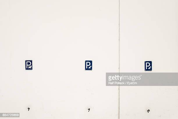 Dog Parking Signs On White Wall