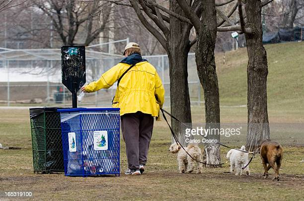 Dog PoopAndy Heap and his dogs Buffy Fifi and Misty take a stroll at Withrow Park on Tuesday April 10 2007Dog owners may have to poop scoop and take...
