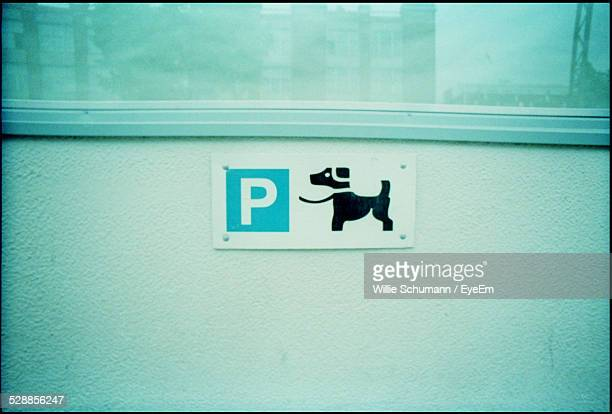 Dog Sign On Wall