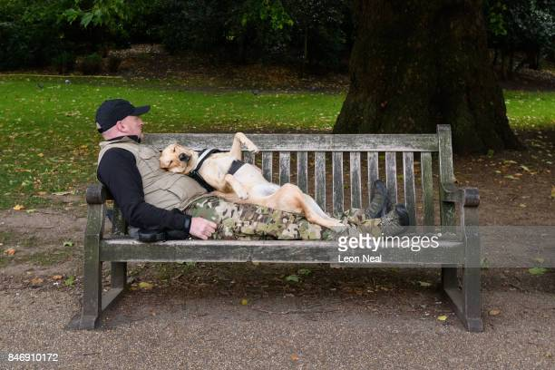 A dog sleeps in a state of total relaxation on it's owner in St James' Park on September 14 2017 in London England