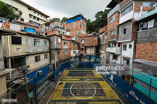 Dog sleeps on a concrete soccer pitch in favela
