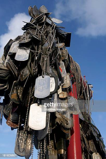 dog tags from marines and sailors hang in front of a memorial in iwo jima. - marine corps war memorial stock pictures, royalty-free photos & images