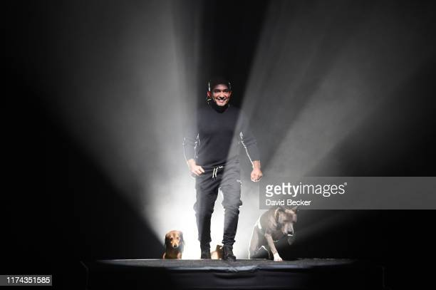 """Dog trainer and television personality Cesar Millan performs during the opening night of his one-man show """"Cesar Millan - My Story: Unleashed"""" at the..."""