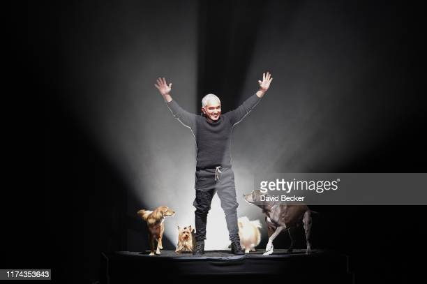 """Dog trainer and television personality Cesar Millan performs with some of his dogs during the opening night of his one-man show """"Cesar Millan - My..."""