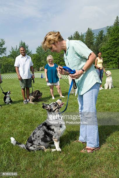 Dog trainer demonstrating exercise for class