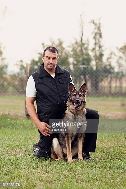 dog trainer with a german shepherd - beroepen met dieren stockfoto's en -beelden