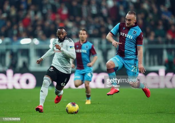 Dogan Erdogan of Trabzonspor and Georges-Kevin N'Koudou of Besiktas challenging for the ball during Besiktas against Trabzonspor on Vodafone Park,...