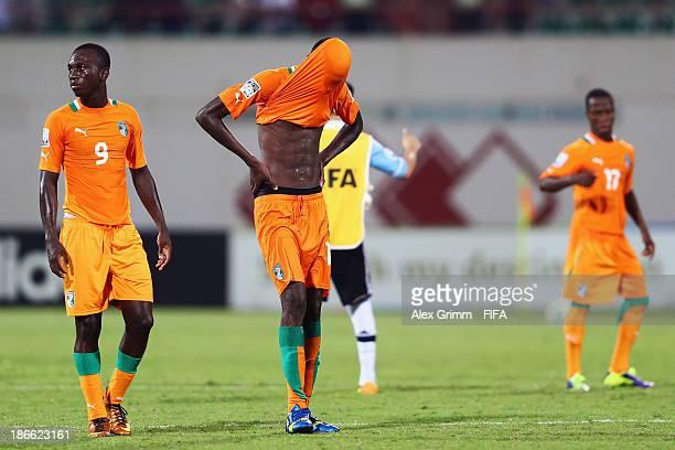 Dogbole Niangbo and Aboubakar Keita of Ivory Coast react after the FIFA U17 World Cup UAE 2013 Quarter Final match between Argentina and Ivory Coast...