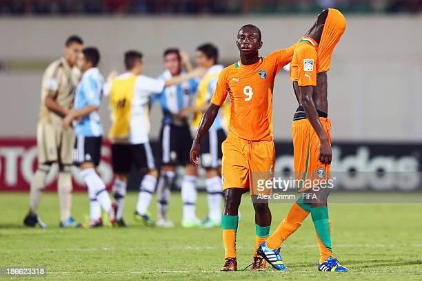 Dogbole Niangbo and Aboubakar Keita of Ivory Coast react as players of Argentina celebrate after the FIFA U17 World Cup UAE 2013 Quarter Final match...