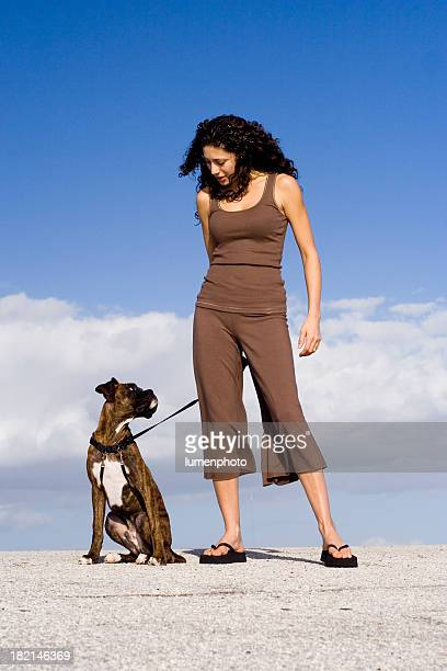 doggy listen - girl blows dog stock photos and pictures