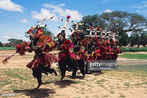 Dogon dancers wearing Kanaga masks performing the Dama or masked funeral dance Bandiagara Escarpment Mali
