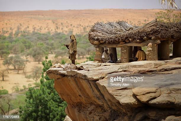 Dogon elder stands by Toguna building in Mali